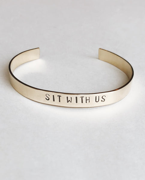 SIT WITH US Hand-Stamped Brass Cuff by Tech Wellness