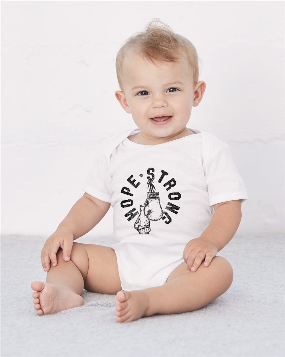 HOPE Strong Boxing Gloves Baby Cozy Graphic Tee Onesie