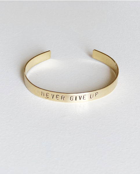 NEVER GIVE UP Hand-Stamped Brass Cuff