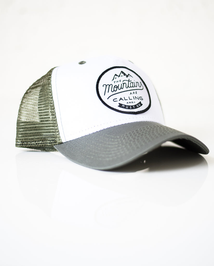 THE MOUNTAINS ARE CALLING Green Trucker Cap