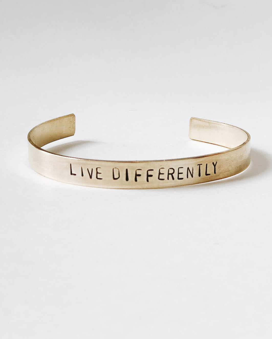 LIVE DIFFERENTLY Hand-Stamped Brass Cuff