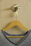 Anti Theft Hotel Hanger - Clothes hanging on bathroom door with the CovertAHanger