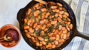 Braised White Beans with Greens and Harissa