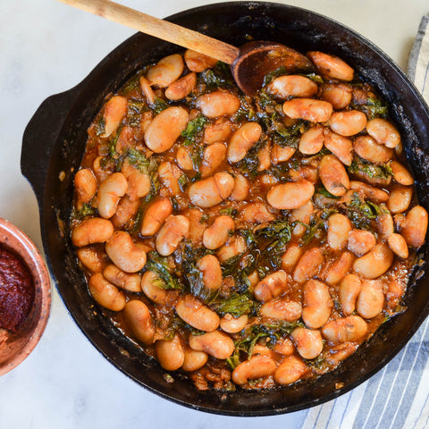 Braised White Beans and Greens with Harissa