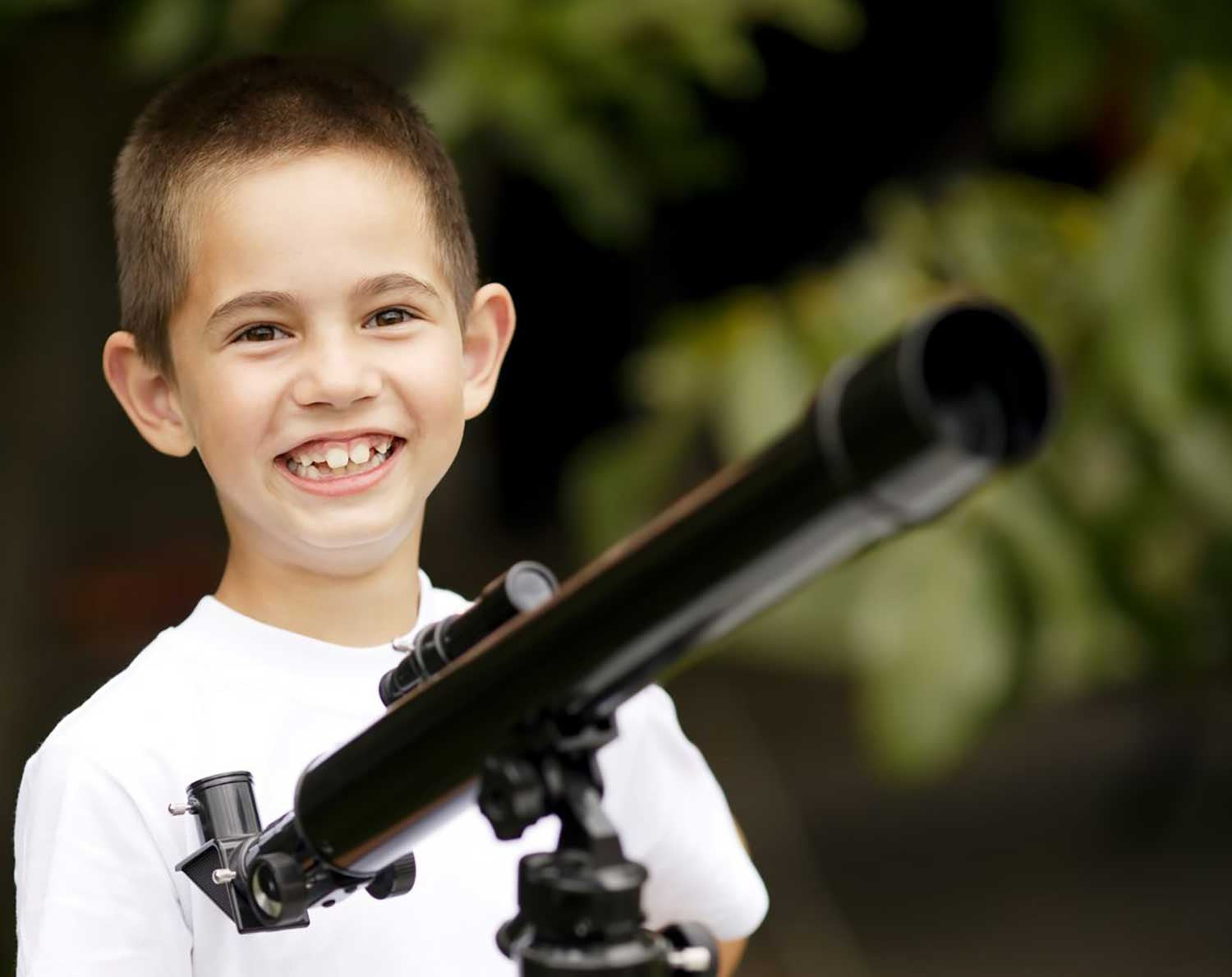 Child using telescope