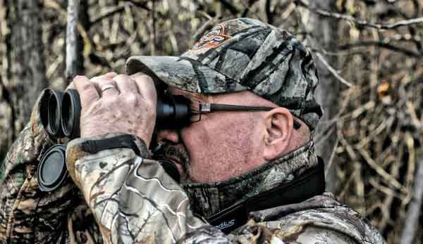 Man using Snypex binoculars