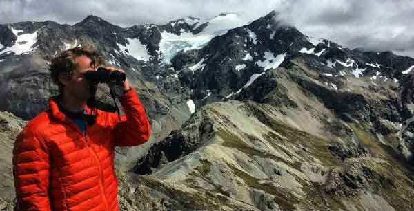 Man using binoculars in mountains