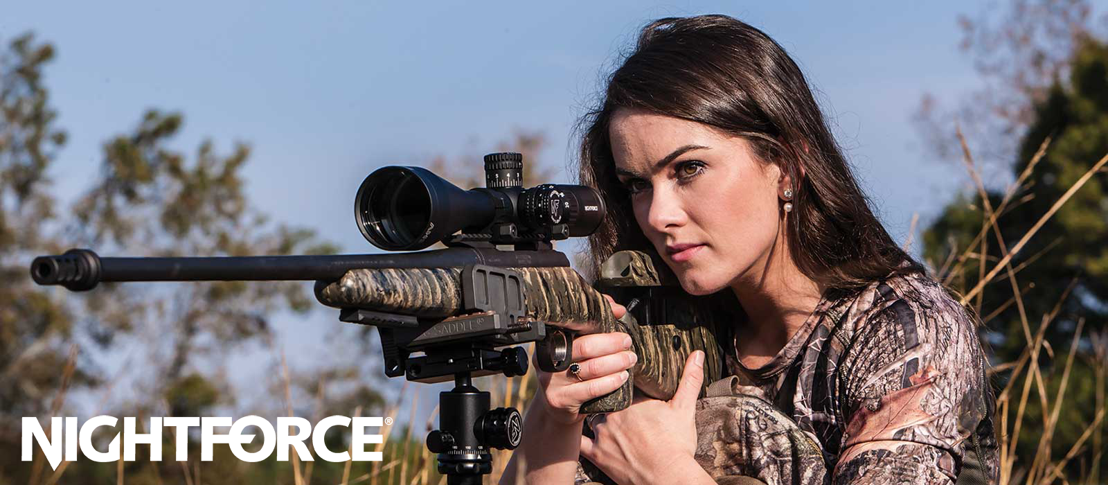 Woman using Nightforce riflescope