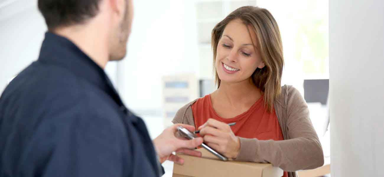 Woman signing for parcel