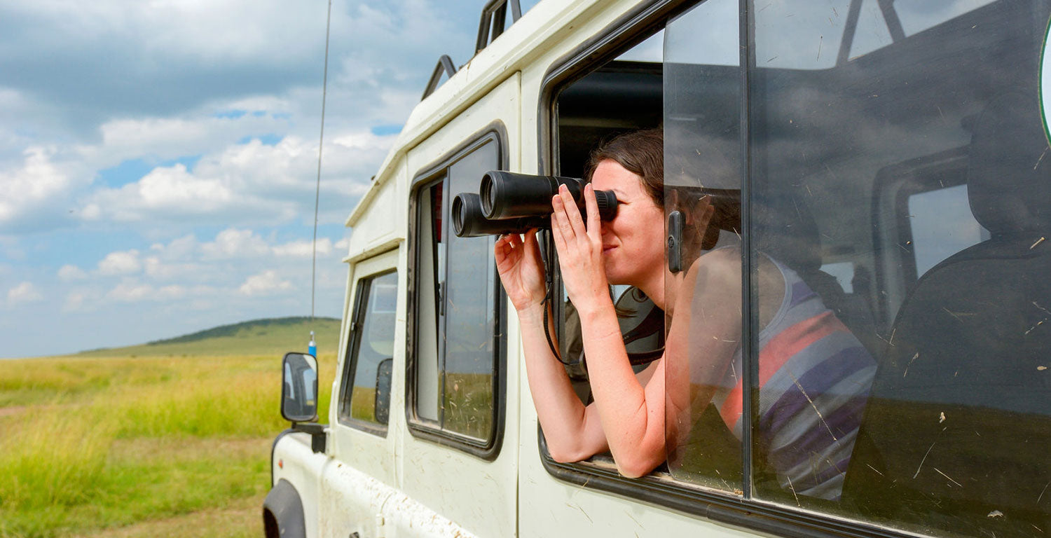 Using binoculars on safari