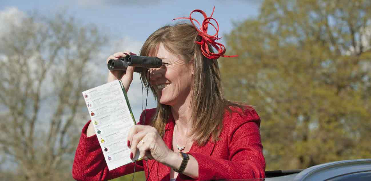 Woman using binoculars for spectating