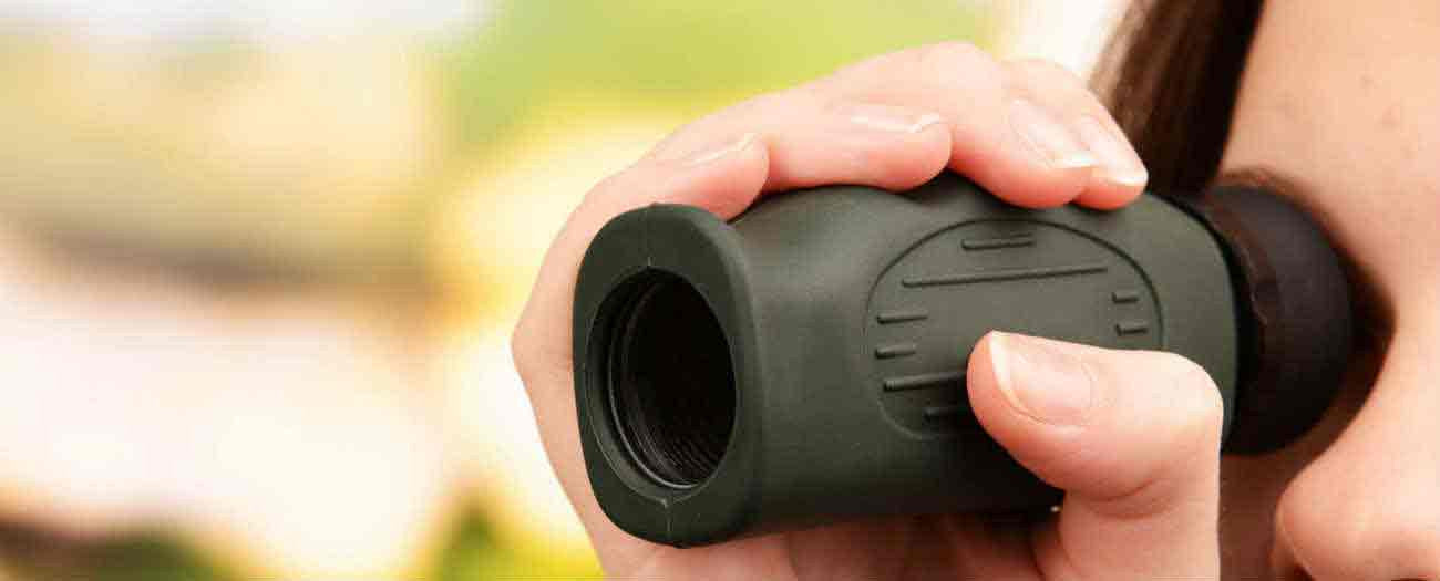 Woman using monocular
