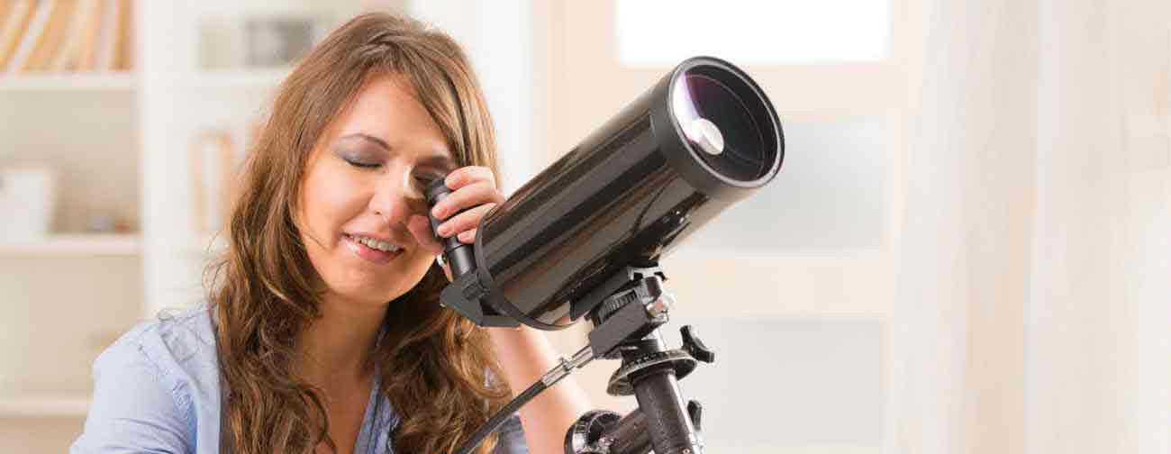Woman using telescope