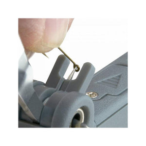 Carson Fish'n'Grip Pro 4.5x Hand Magnifier with Reverse Action Tweezers, Magnetic Hook Cleaner and Line Cutter in use
