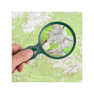 Carson MagniView 2x Outdoor Hand Magnifier with 4x Spot Lens in use