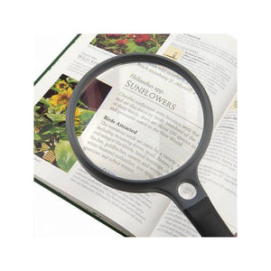 Carson SureGrip SG-12 2x Hand Magnifier with 11.5x Spot Lens - Medium in use