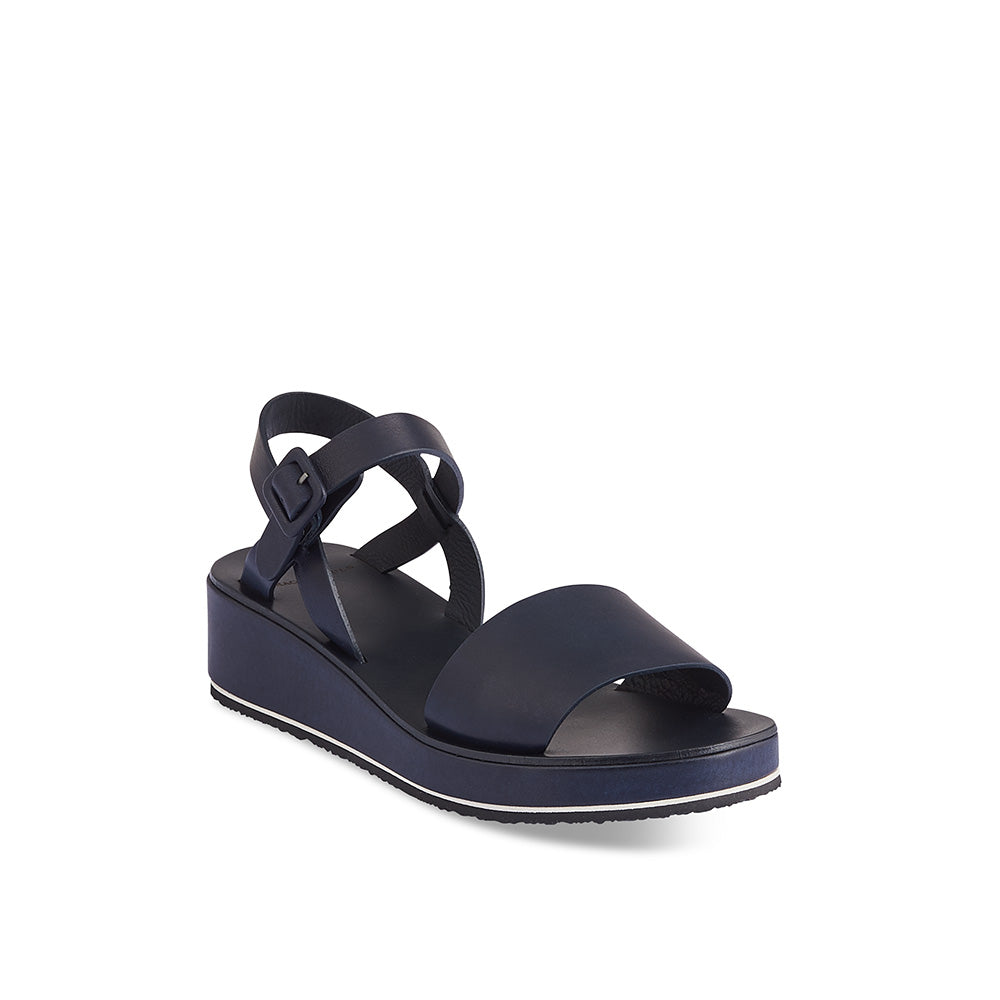 An all-new summer sandal from Tracey Neuls, Barbara has a lovely wedge shaped sole featuring a playful white EVA layer. The soft navy leather upper is extremely comfy on the foot and the cross-straps at the heel provide the perfect fit with minimal coverage.
