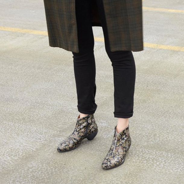 The versatile Beverly ankle boot features a soft embossed patent upper with a black-and-gold 'night flower' motif. With a contoured rubber sole that is equally comfortable and stylish, this boot's striking design is finished with a sculpted, accommodating toe and fine gold trim details.