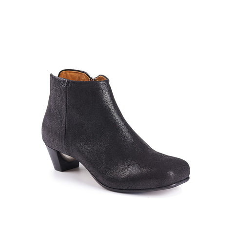 A gorgeous low ankle boot, Brook features a subtle heart-shaped toe, inside zip and slim leather sole with rubber inlay. Tracey has added a silver bubble detail under the mid-height heel that catches the light and creates a sculptural silhouette.