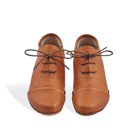 A traditional lace-up reimagined by Trippen, Cello is a wear-anywhere oxford with clean lines and a leather toe cap stitched over the top of the sole. This versatile shoe in gorgeous tan is an easy addition to the year-round wardrobe.