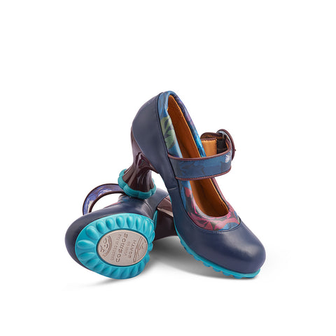 Sitting atop the sculptural Cosmos heel, the Ceres in supple navy leather features plush piping and ankle strap in contrast floral leather. The turquoise heel and sole are quintessential Fluevog flourishes and the soft leather lining ensures all-day comfort.