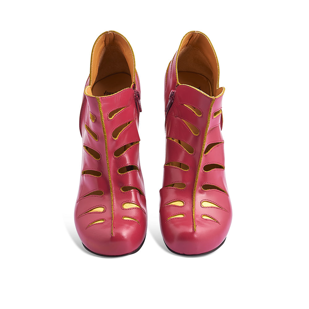 Crafted in Portugal from smooth Italian leathers, Modotti is as fierce and original as her artist/activist namesake. The unlined rich berry leather upper is accented with teardrop cutouts and features an inside zipper. The concealed platform and leather/EVA stacked heel combine for a comfortable feel underfoot.