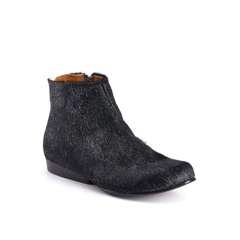 This elegant ankle boot combines Tracey's signature design features with luxurious leathers and subtle detailing. With a slim leather sole and elongated heel block, the black 'pony' leather upper has been brushed with silver for a subtle metallic edge.