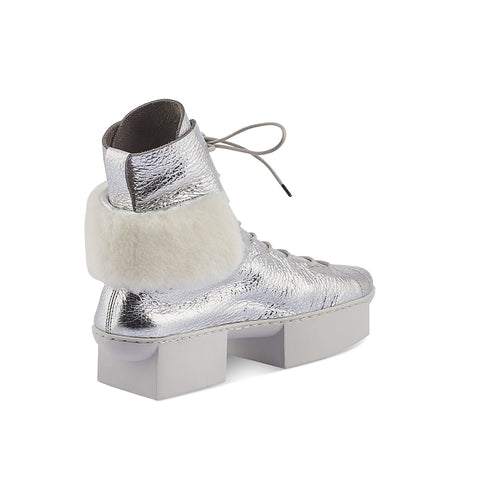 Sitting atop Trippen's iconic 'box' platform sole, Couch features a sporty hightop design with a chic shearling panel above the heel. This fabulous one-of-a kind luxury trainer has extended lacing for a perfectly snug fit on any foot and features a contoured leather insole that offers both support and stability.