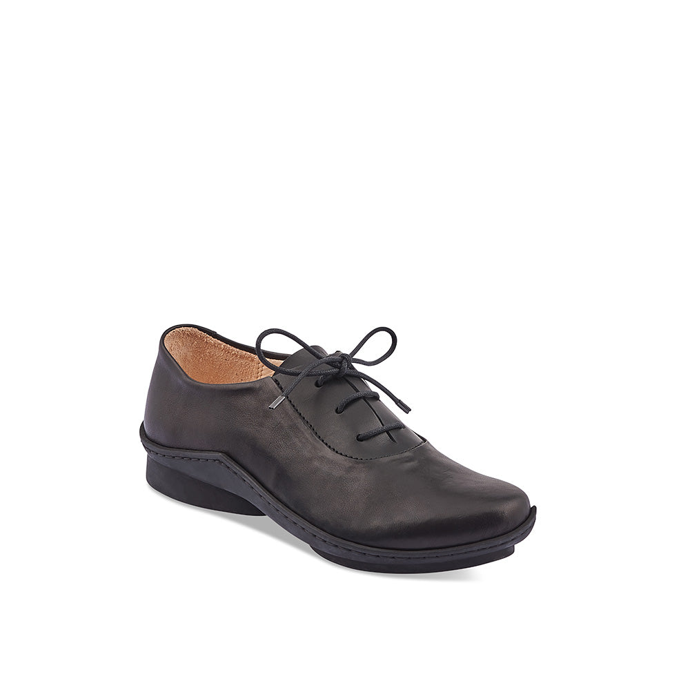 A sporty oxford-style lace up with clean lines and a slim silhouette, Crater is a prime example of Trippen's ability to reinvent a classic shape. The minimalist design features a contrast waxed leather panel at the laces that accentuates the modern feel and the durable 'wave' sole is supportive and comfortable.