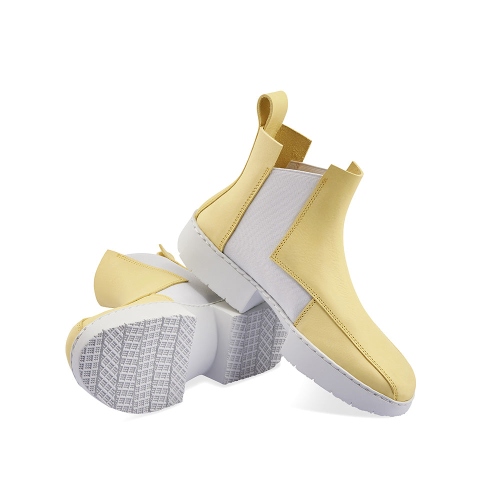 Designed with interlocking rectangular panels, Crust sits on the ultra-comfortable 'sport' platform sole and features a captivating light yellow leather upper. The angular elastic gussets sit perfectly on the ankle and the geometric elements add to the boot's modern feel.