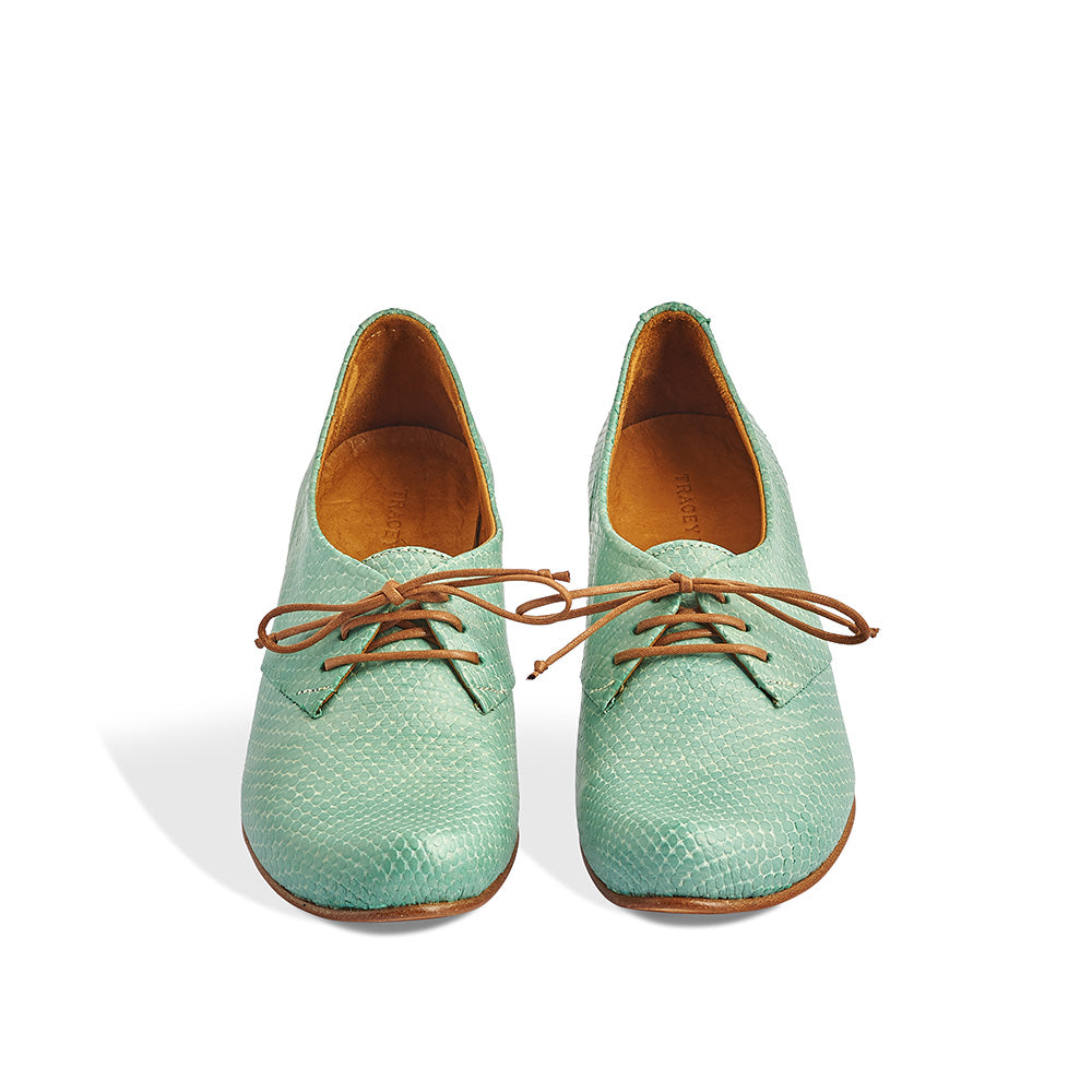 A soleDevotion favourite, Denis by Tracey Neuls has a gorgeous half-moon heel shape that's as comfortable as a flat. This versatile lace up combines a slim leather sole with a classic derby upper in soft, textured kiwi green leather.