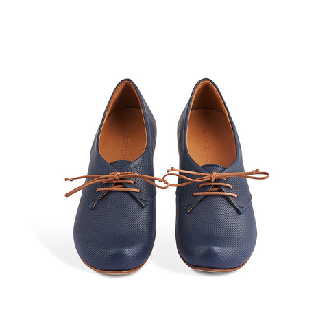 One of Tracey Neuls' signature designs, Denis has a gorgeous toe shape, slim silhouette and a low half-moon heel that's as comfortable as a flat. This versatile lace up combines a supple pin-pricked navy leather upper with a fine leather sole signed by the artisan.