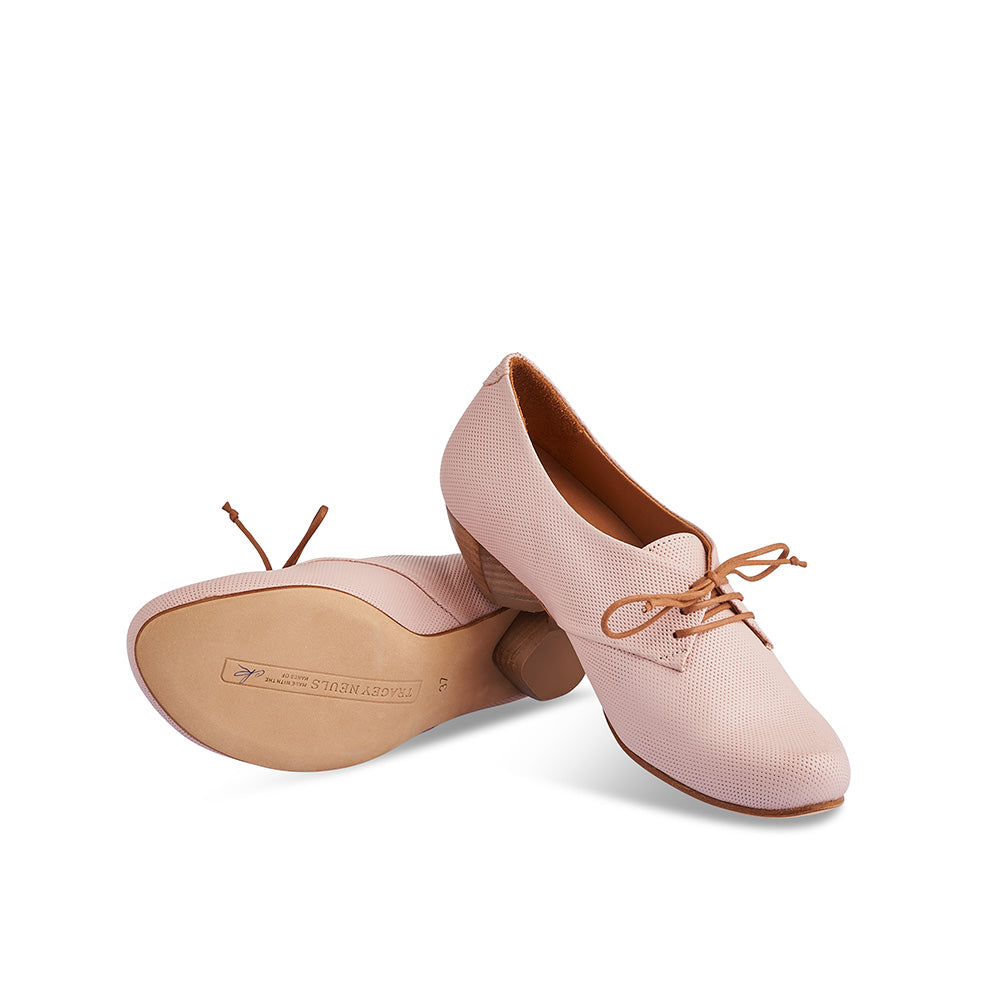One of Tracey Neuls's signature designs, Denis has a gorgeous toe shape, slim silhouette and a low half-moon heel that's as comfortable as a flat. This versatile lace up combines a supple pin-pricked blush pink leather upper with a fine leather sole signed by the artisan.