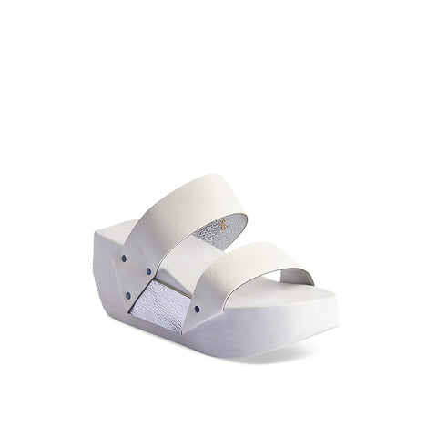 A scene-stealing summer party option, Double features unlined leather straps and striking white/nickel contrast tones. The lightweight wood section has been painted brilliant white and the sculpted footbed ensures a supportive fit.
