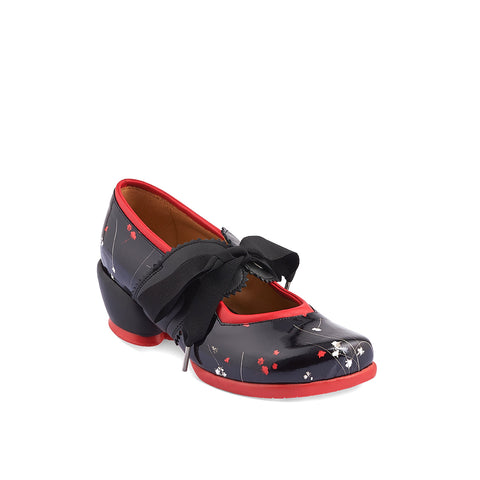 An adorable Mary Jane with grosgrain ribbon lacing, Adele is perched on a leather-wrapped heart shape heel that's as comfy as a flat. The leather upper features a floral print underneath a high-gloss finish and the design is finished with a contrast leather trim and rubber sole.