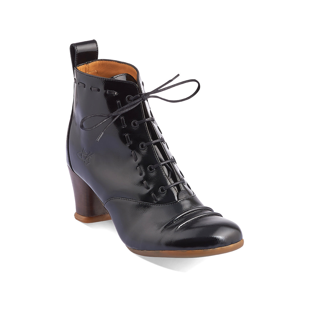 "Named after the Italian mezzo-soprano, the timeless Bartoli returns to soleDevotion in beautiful glossy black leather. This gorgeous lace-up boot secures neatly around the ankle and John Fluevog's ever-popular Operettas heel makes Bartoli supremely comfortable on any surface. ""Your Love Makes Me Sing!"""