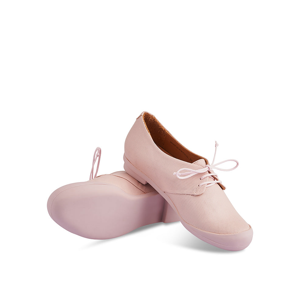 The iconic Geek by Tracey Neuls returns this season with a new rounder toe shape, making it more comfortable than ever. An ideal alternative to a trainer, this wear-anywhere style was described by The London Design Museum as 'a beautiful shoe for an active life'. This new version features a rose upper with fine pin-pricked perforations and a matching rubber sole.