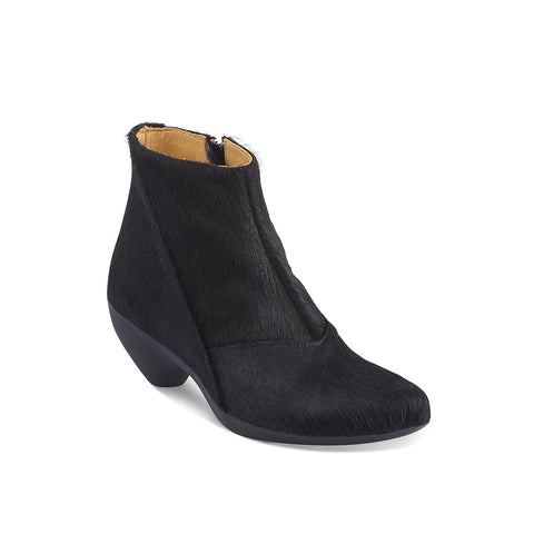 This sleek ankle boot by Tracey Neuls features a custom glossy black pony finish that performs exceptionally well in wet and wintery conditions. The versatile Ginger has a subtle inner zip and Tracey's signature sculpted toe shape and super-comfy rubber sole and heel.