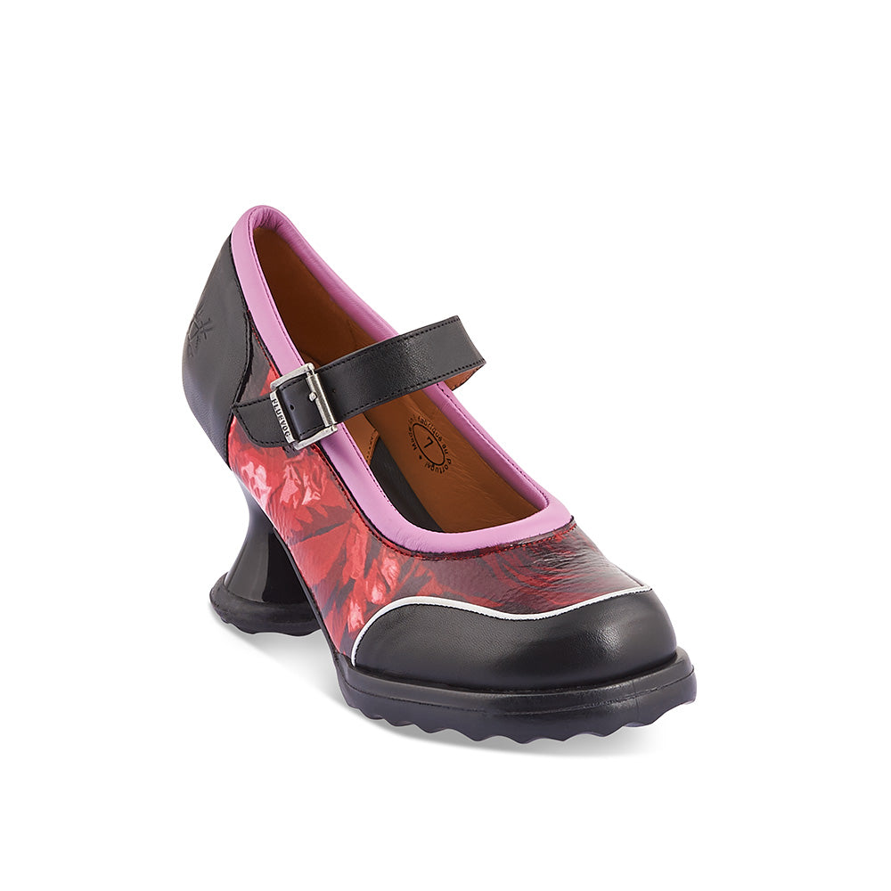 A classic Fluevog from the archives, this special-edition Gorgeous features John's iconic hourglass Mini heel and the durable rubber 'F' sole. This bold statement heel boasts a generous fit, cute contrast piping and curves galore - Gorgeous is an eye-catching party option with all-day wearability.