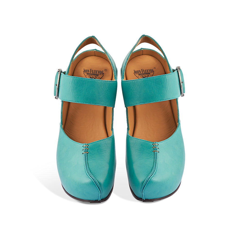An iconic shape by John Fluevog, the Guide returns to soleDevotion in gorgeous soft turquoise. Featuring supple leather uppers, custom Fluevog buckles and a 3.5-inch curved heel, Guide also has a concealed 1.5-inch recycled cork platform for all-day comfort. This uber-modern Mary Jane clog provides you with a firm foundation for the challenges ahead - Prepare for the Future, choose well today!