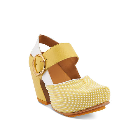 John Fluevog dazzles once again with the adorable Guide in yellow. Featuring a textile front section with microdot resin motif, supple leather uppers and a 3.5-inch curved heel, Guide also has a concealed 1.5-inch recycled cork platform. This uber-modern Mary Jane clog provides you with a firm foundation for the challenges ahead - Prepare for the Future, choose well today!