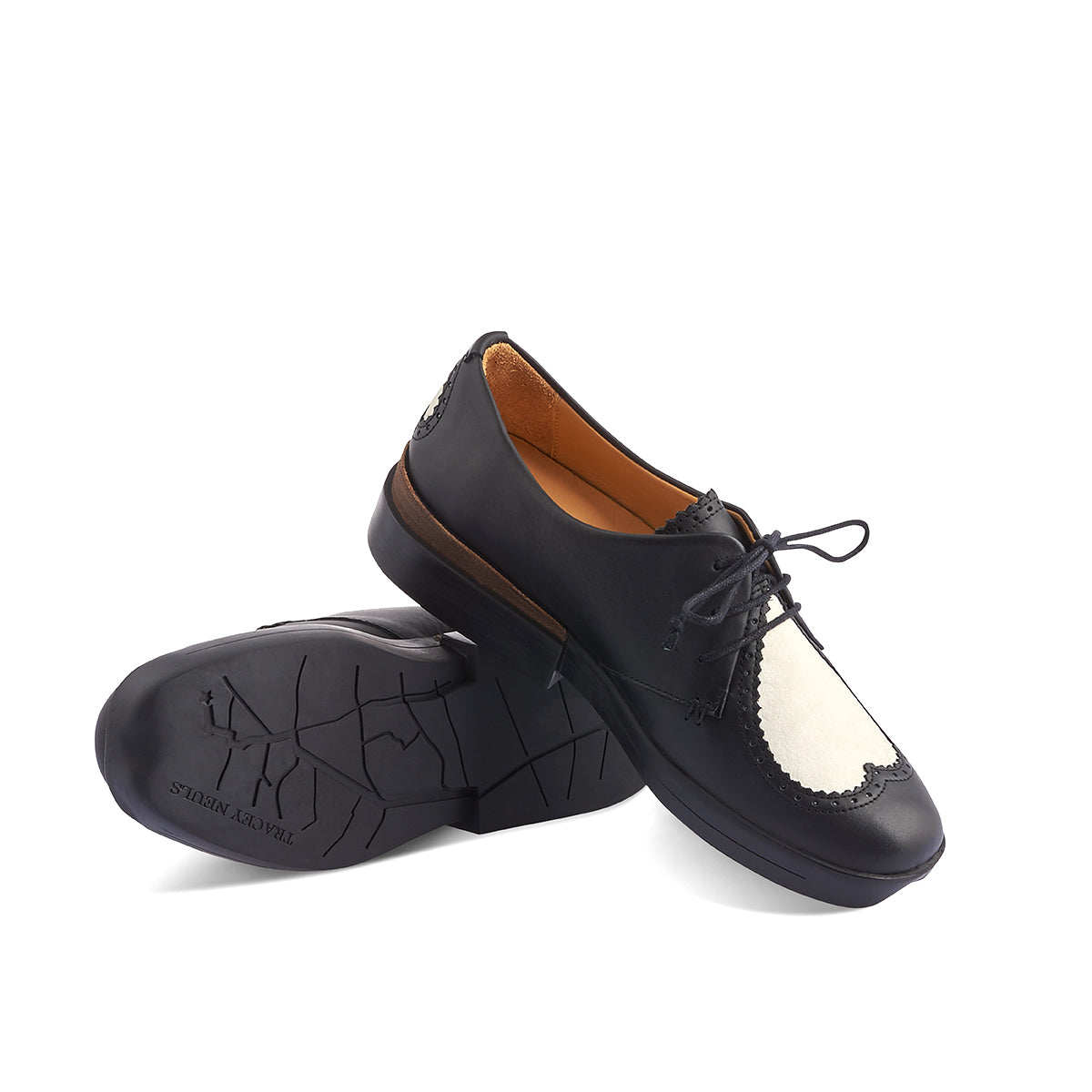 With an adorable velvet heart detail front and centre, Heart is delightful contemporary Derby by Tracey Neuls with a luscious black leather upper. Set on a chunky yet lightweight and super-soft rubber sole, this lace-up is one of the most comfortable shoes you'll ever wear.