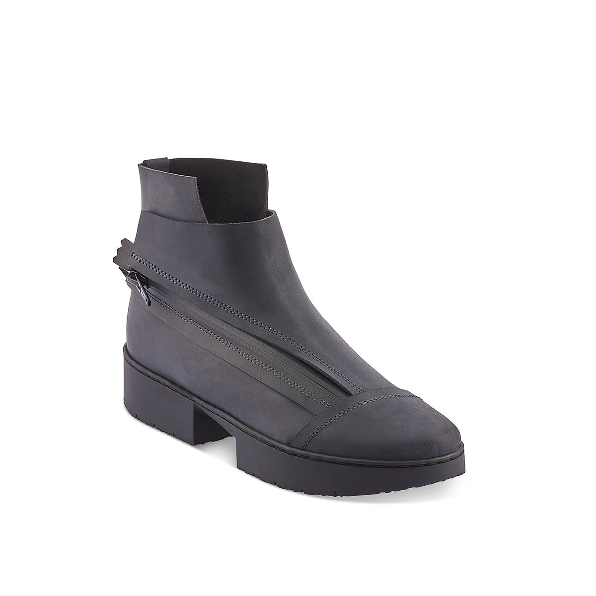 An ultra-modern ankle boot crafted from lightly oiled leather, Immature sits atop the flat-form 'sport' sole. The angular zip is covered with a stitched rubber section and the leather upper wraps around the ankle, creating dynamic lines and a sculptural silhouette.