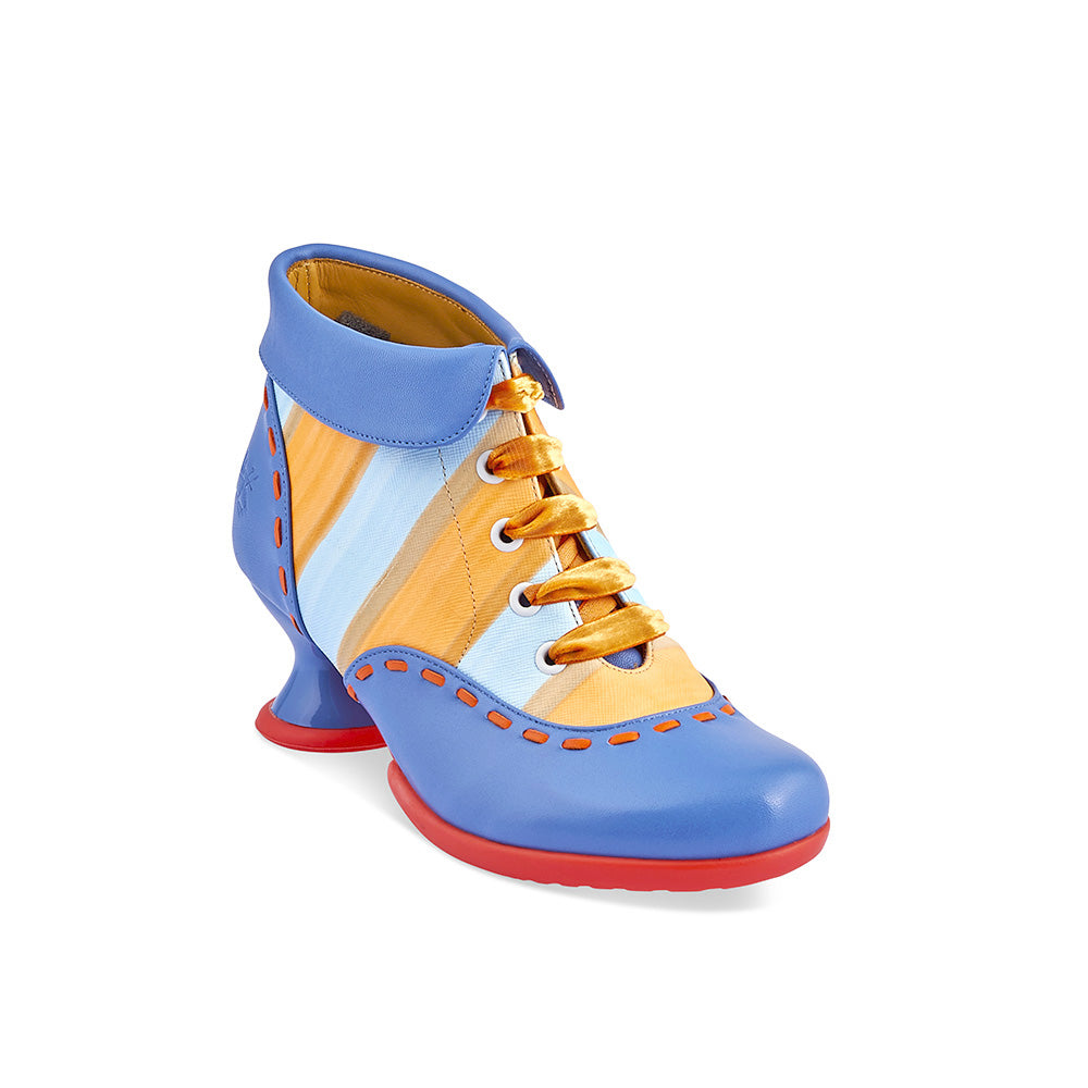She's back! In a gorgeous combination of soft blue leather and painted orange stripes, the new Investigator also features contrast orange stitching and cute ribbon lacing. This dazzling ankle boot from John Fluevog is the perfect antidote to grey winter days!