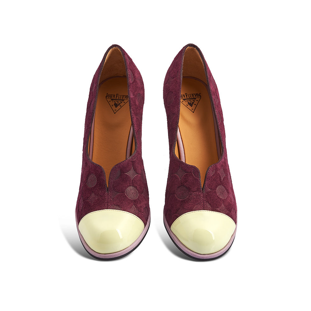 Iris is a delightful pump from John Fluevog featuring a rich burgundy suede upper and contrast patent lemon toe. The upper is stamped with an abstract floral motif and the subtle pink rand completes the playful look.