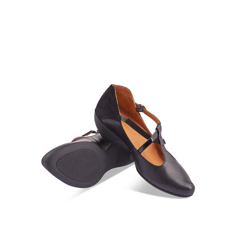 The ever-popular Jazz by Tracey Neuls returns this season with an exquisite 3-tone leather/patent/suede upper. A contemporary take on a t-bar, this gorgeous heel has elegant asymmetric straps and an easy fit that belies her slim silhouette.