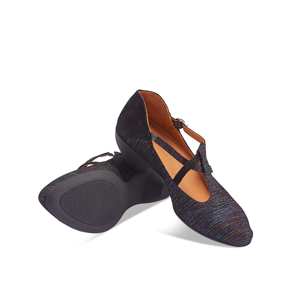 The ever-popular Jazz by Tracey Neuls returns to soleDevotion with a custom printed leather upper with contrasting suede panels and elegant asymmetric straps. A contemporary take on the t-bar, this gorgeous heel has an easy fit and true day-to-night versatility.
