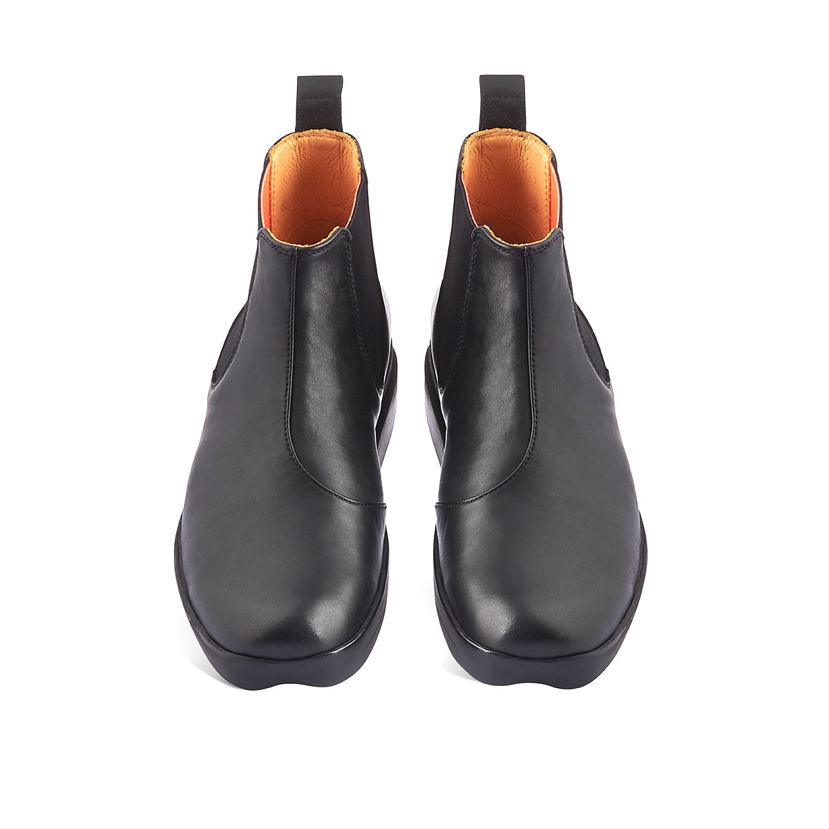 Tracey Neuls' contemporary Chelsea boot Jon returns to soleDevotion by popular demand. The sturdy yet supple leather upper sits beautifully on the chunky yet lightweight and cushioned rubber sole. This versatile ankle boot features an accommodating fit and reinforced elastic gussets with playful neon orange inner panels.