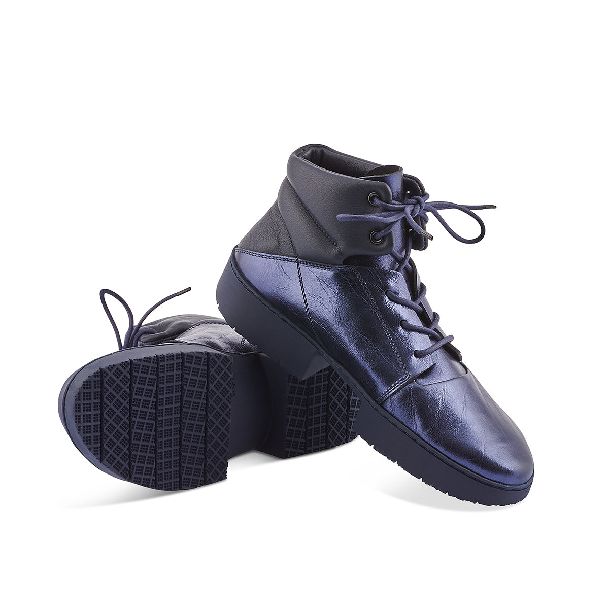 A sporty hightop by Trippen, Jump has a midnight navy metallic leather upper and contrast navy panels at around the ankle. The textured and hard-wearing 'sport' sole is a brilliant option through winter and the contoured leather footbed provides the right amount of support.