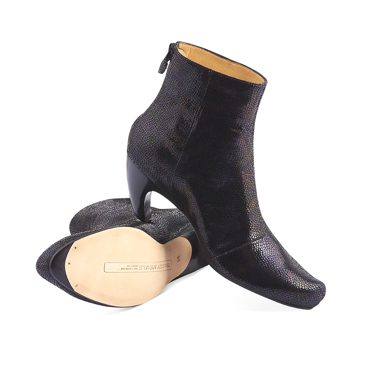 A stunning dress boot from London's Tracey Neuls, King features a sumptuous 'prism' leather upper with a fine faux-snake finish and a rich palette of darks that blend to an iridescent black. The shapely heel creates a beautiful line that flatters the leg and the slim leather sole is signed by the artisan.